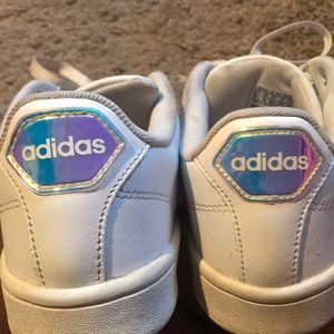 Classic white adidas with a hologram tag